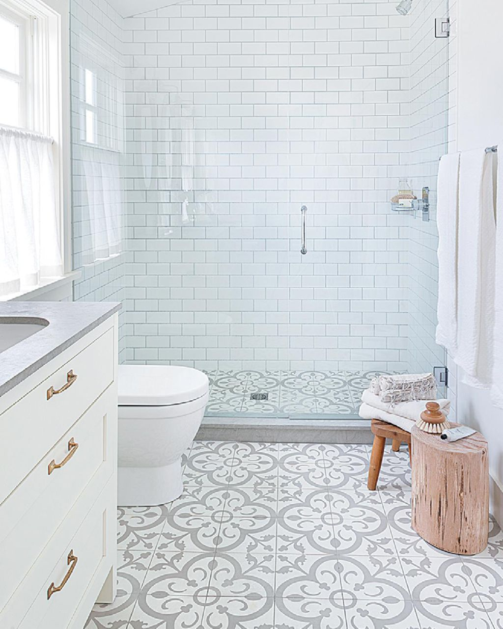 Bathroom carpet online bathroom design 2017 2018 pinterest a not so plain white bathroom with a great walk in shower gray and white patterned encaustic tile floors via dailygadgetfo Image collections