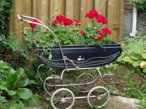A vintage baby carriage to make a flower box.