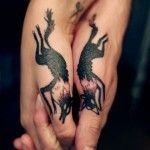 Colorful foxes couple tattoo