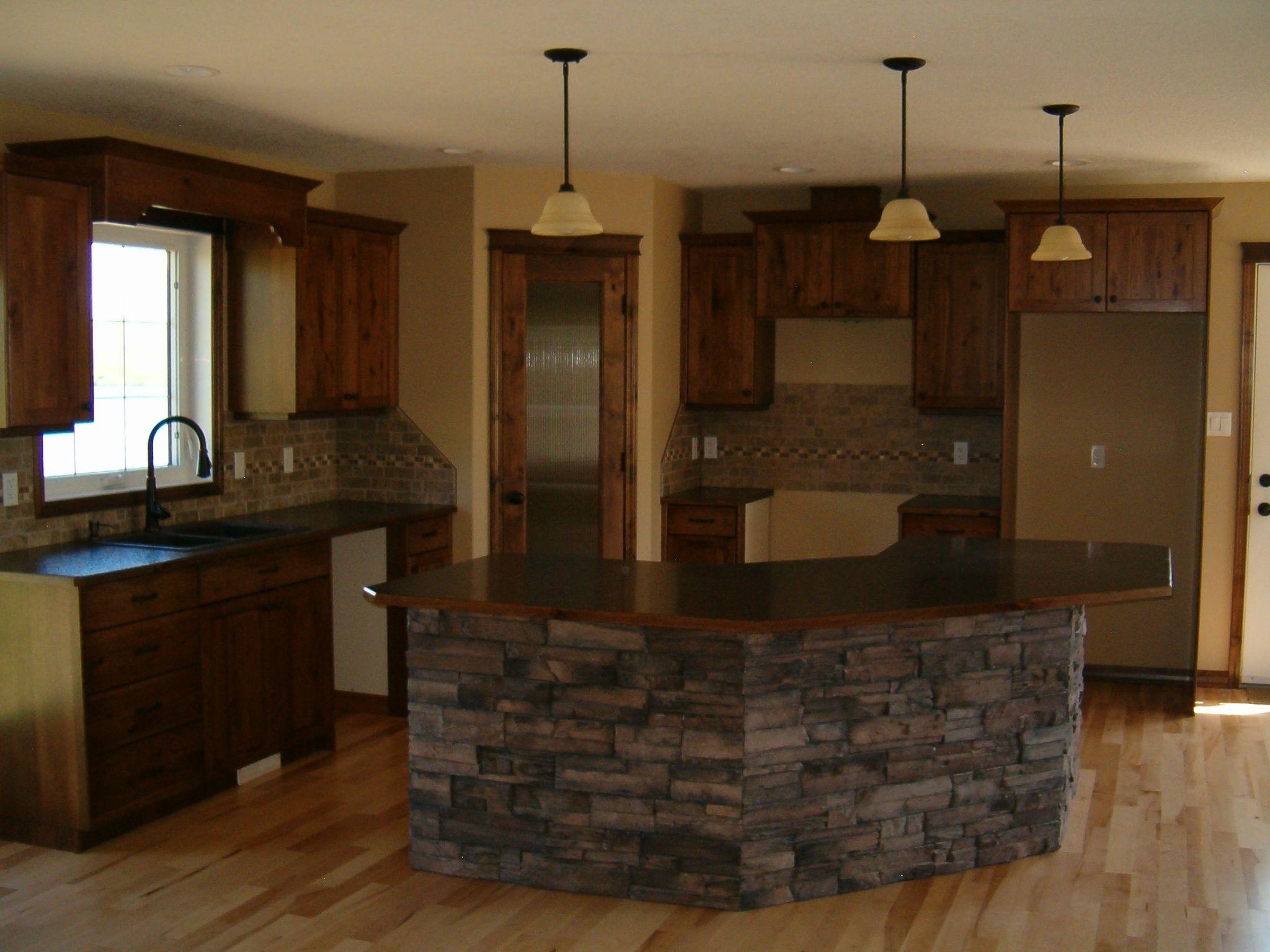 Knotty Alder Kitchen With Cultured Stone On Island Kitchen