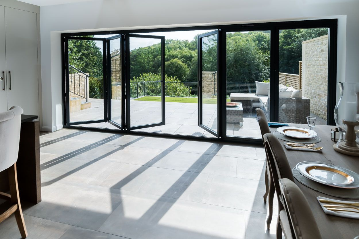 Real Aluminium Bi Fold Door Extend Your Home Into Your Garden Aluminium Doors Aluminium French Doors Bifold Doors
