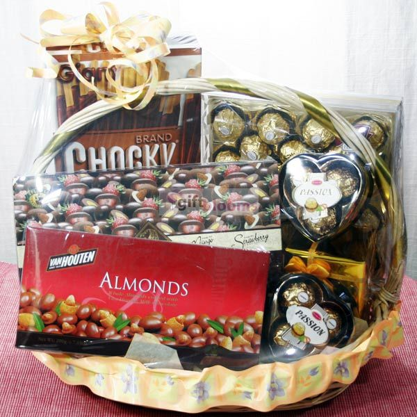 A Beautiful Chocolate Gift Basket Containing Almonds And Chocolate