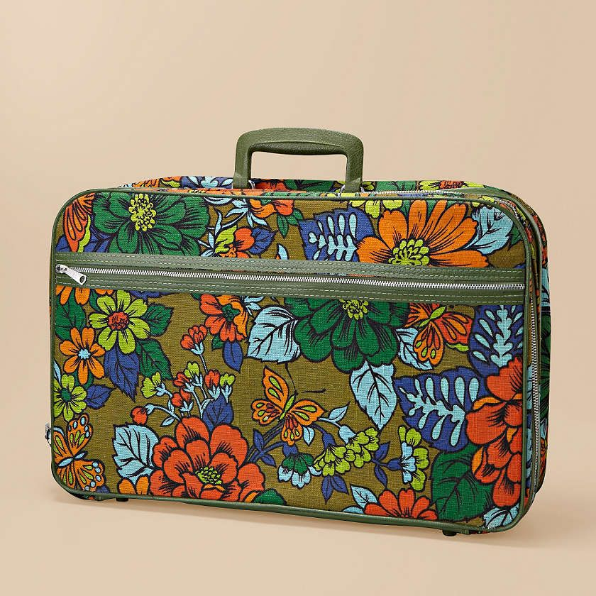With a vibrant floral print and classic silhouette, this vintage suitcase is simply lovely.