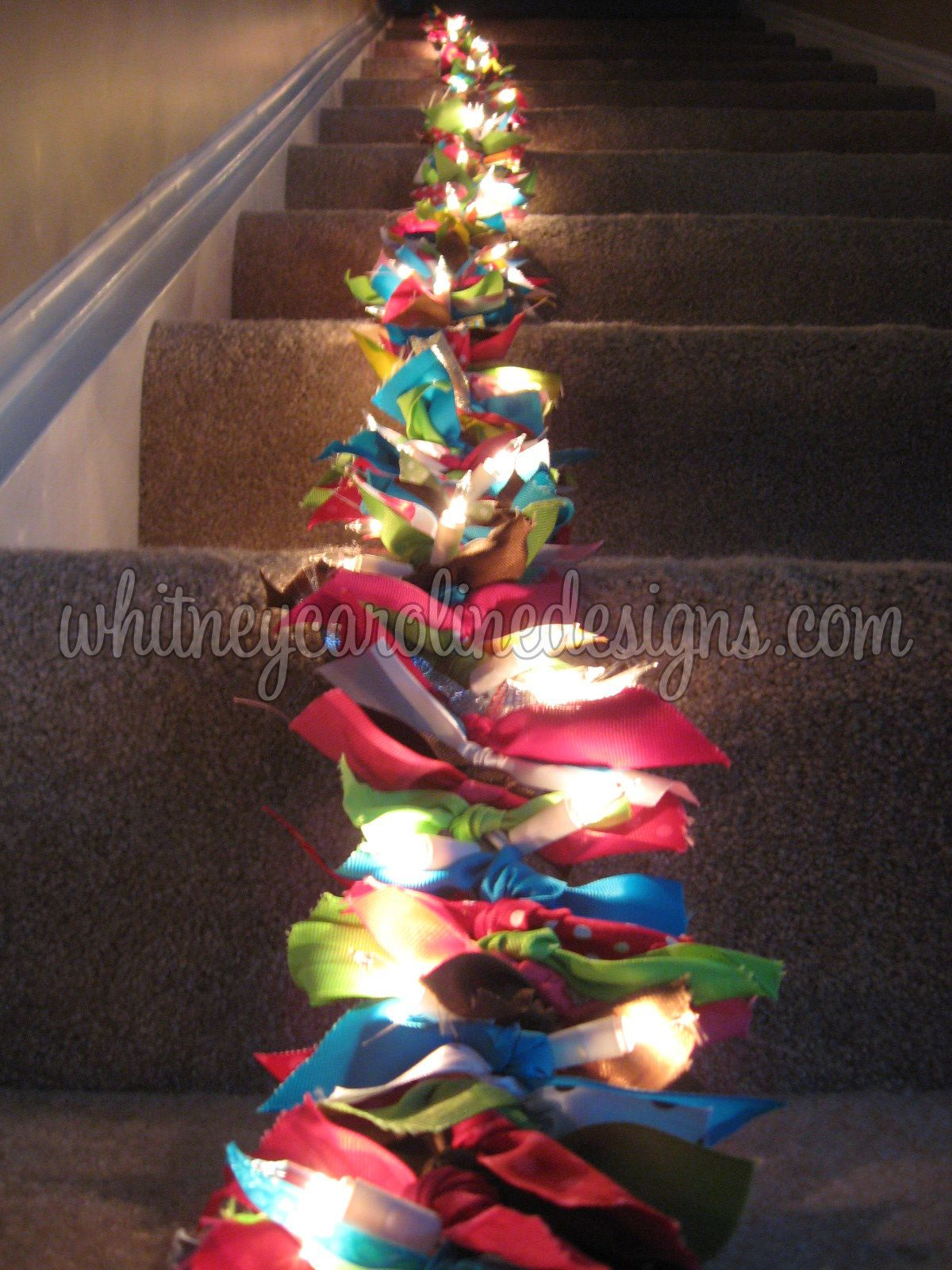 DIY lighted ribbon garland -- string lights + tied on scraps of ribbon = this would probably ...