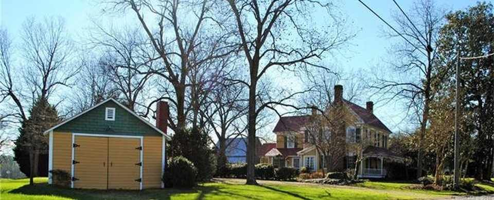 New roof & new HVAC. This 4 bed/ 3 bath home is a must see! 1870's charm with modern updates. Beautiful wood floors, doors & woodwork throughout. High ceilings, shiplap siding. Natural light highlights the character. Large living room, sunroom, 4 fireplaces, 2 staircases, copper tub, cedar lined closets. Detached garage & storage building. Beautifully restored. Large front porch & courtyard. All this on a beautiful, 2 acre corner lot. Own a piece of history. Set an appointment to view today.