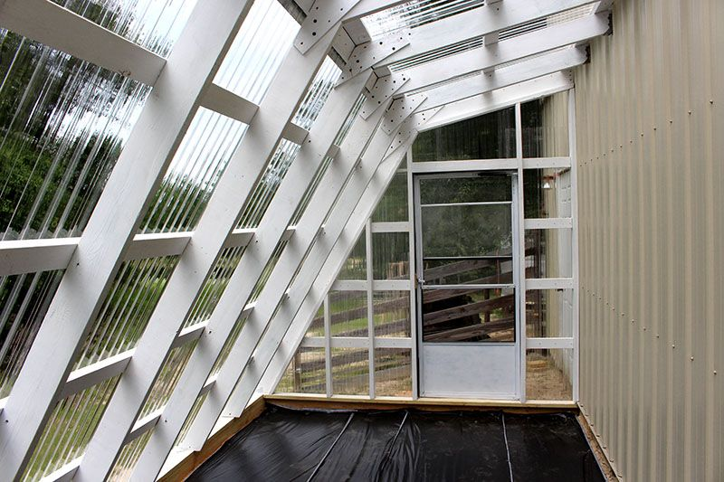 Interior Of Greenhouse Made With TUFTEX PolyCarb Clear Panels In  Perkinston, Mississippi.