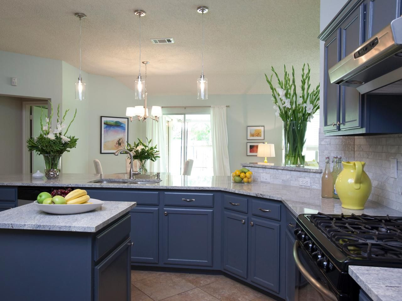 This open floor plan kitchen and living room carry a cool