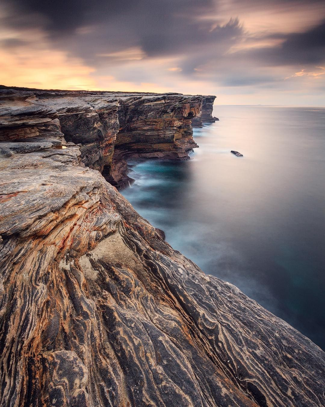 """""""The rugged sandstone cliffs of Potter Point, Sutherland Shire, Sydney. This is one of my favourite spots in Sydney. The cliffs are so majestic and the…"""""""
