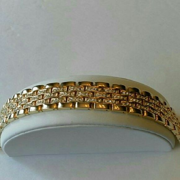 """Stainless steel gold link & rhinestone bracelet Gorgeous gold tone stainless link bracelet drenched with set in pave diamonds. Fits wrist 8"""". Fold over strong hold clasp closure. Brand new with tag. Tarnish free. Great quality and design. Pair this with your favorite watch for a chic and trendy look. Jill Marie Boutique Jewelry Bracelets"""