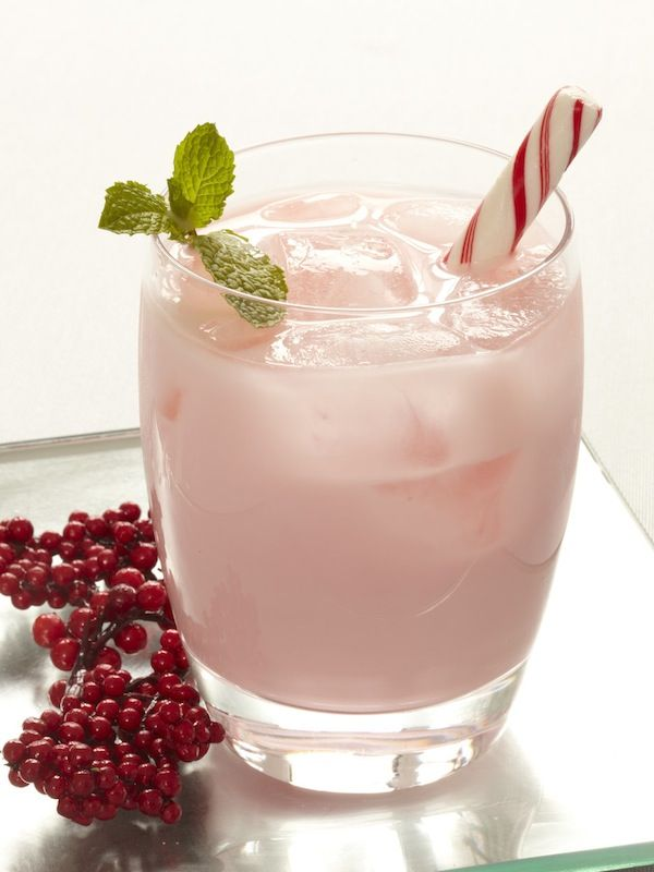 This Candy Cane Cocktail is made from vodka, a splash of white creme de menthe, brandy and garnished with a festive candy cane.
