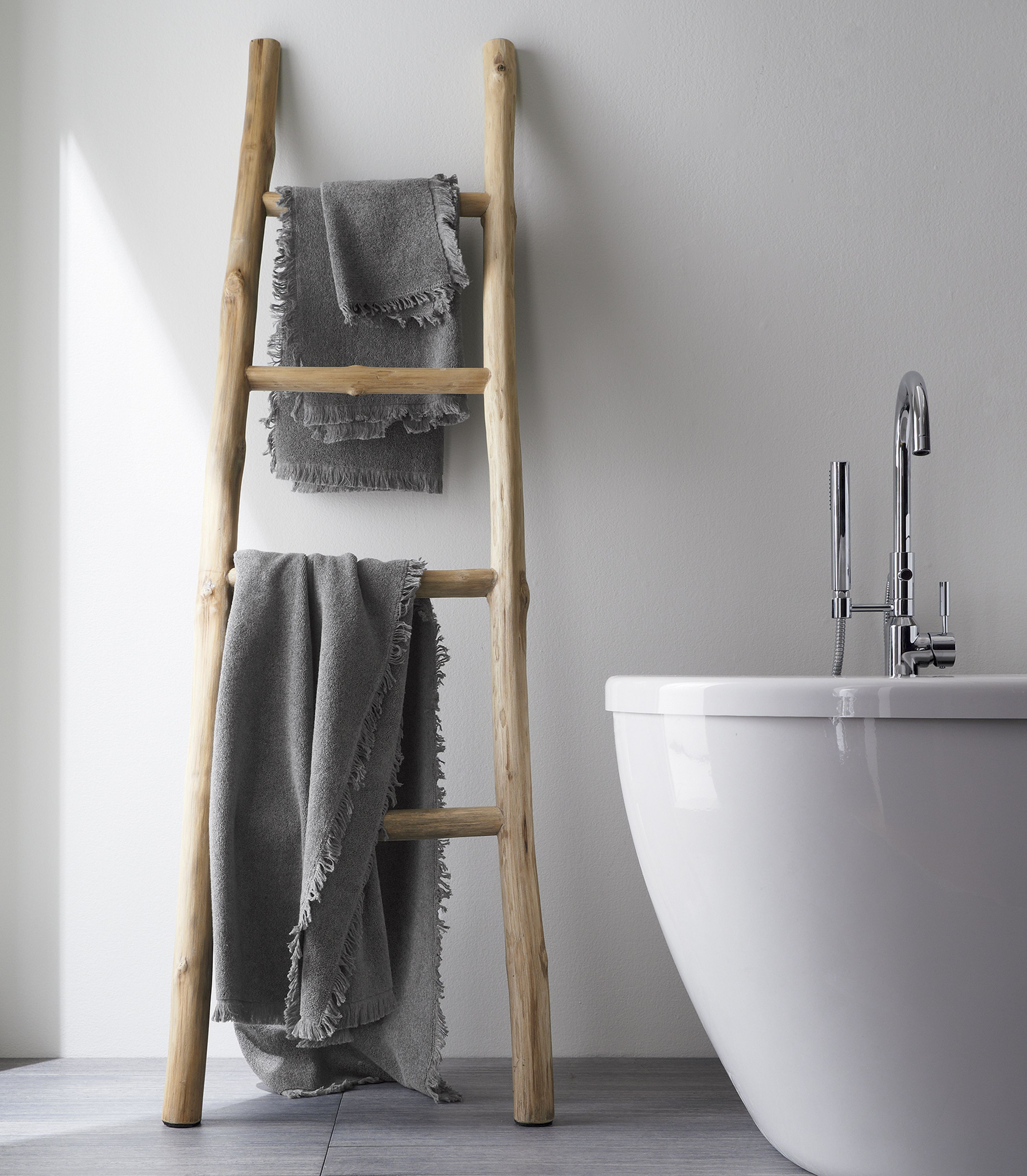 Delicate Fringe Border And Warm Grey Give The Basic Bath Towel A Style Upgrade, Crafted Of Plush