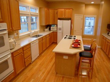 corian countertops with medium oak cabinets   featuring: 10 foot
