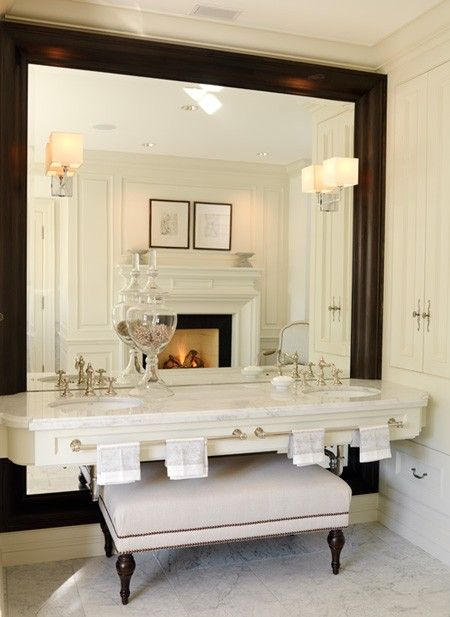 Oversized Mirror + Fireplace in Bathroom Entry