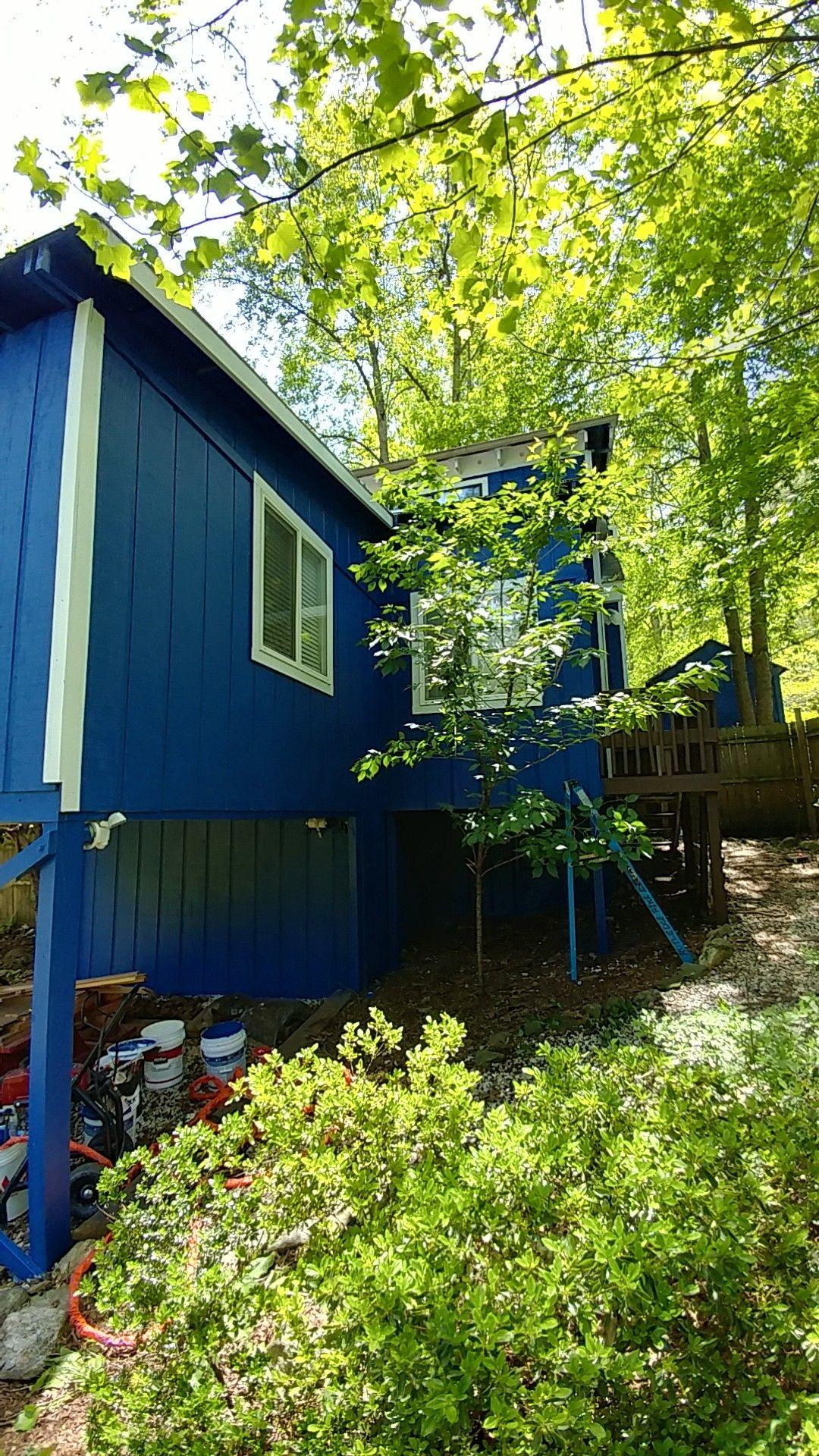 Behr Deck Over in Padre Brown.. Behr door paint in Ruby.. Behr exterior paint in Admiral Blue