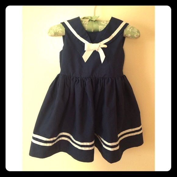 Little girls Size 3T beautiful dress Such an adorable sailor dress for little girl. I don't think my daughter ever wore. Dresses