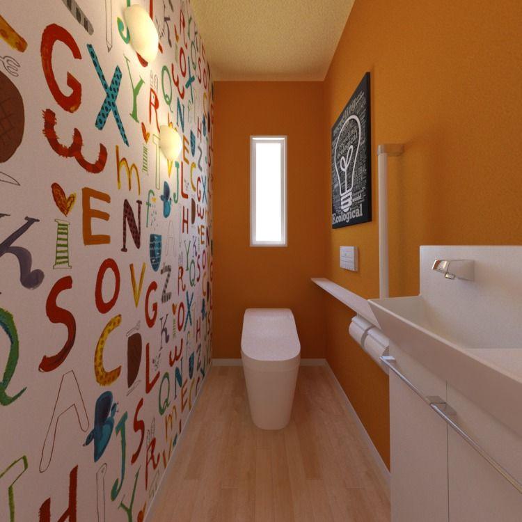 ビビットなオレンジにポップな壁紙が映える 明るく楽しいトイレ空間を演出しました リフォーム インテリアアーキテクチャ インテリア