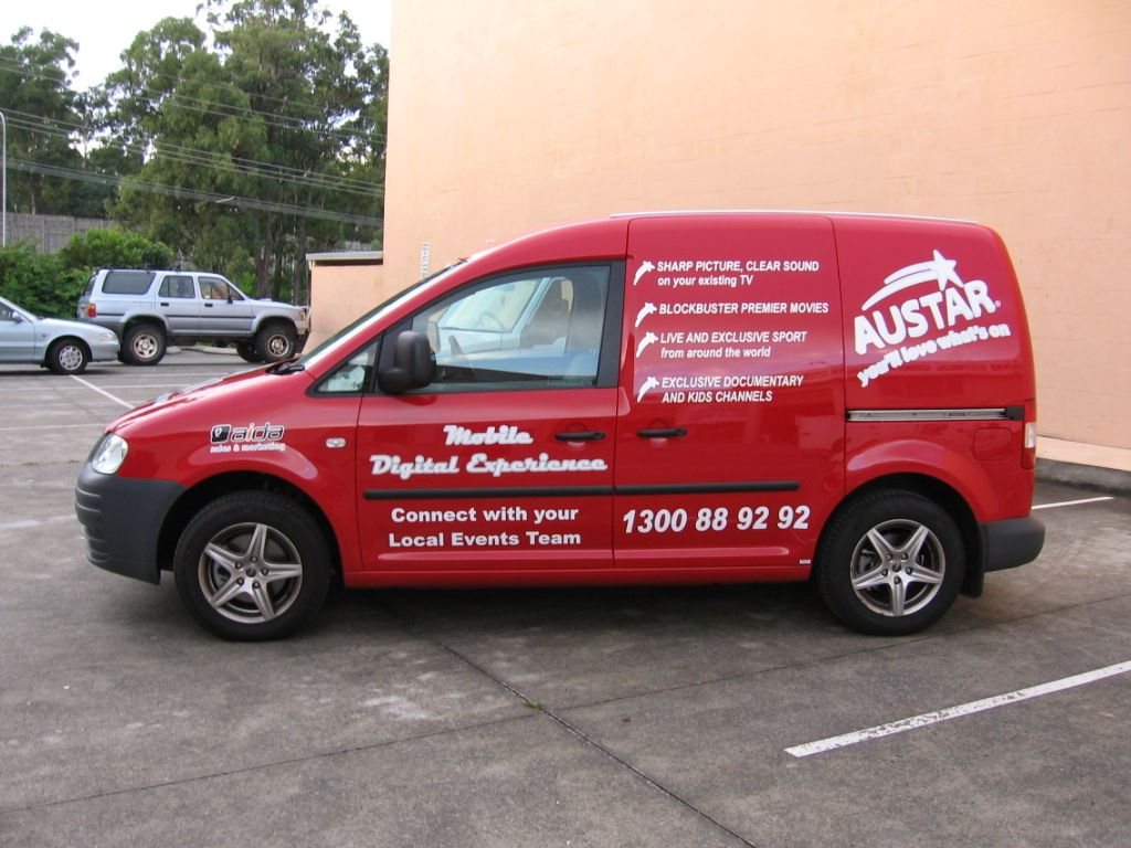 VW Caddy passenger side red with white text | Vehicle branding ...