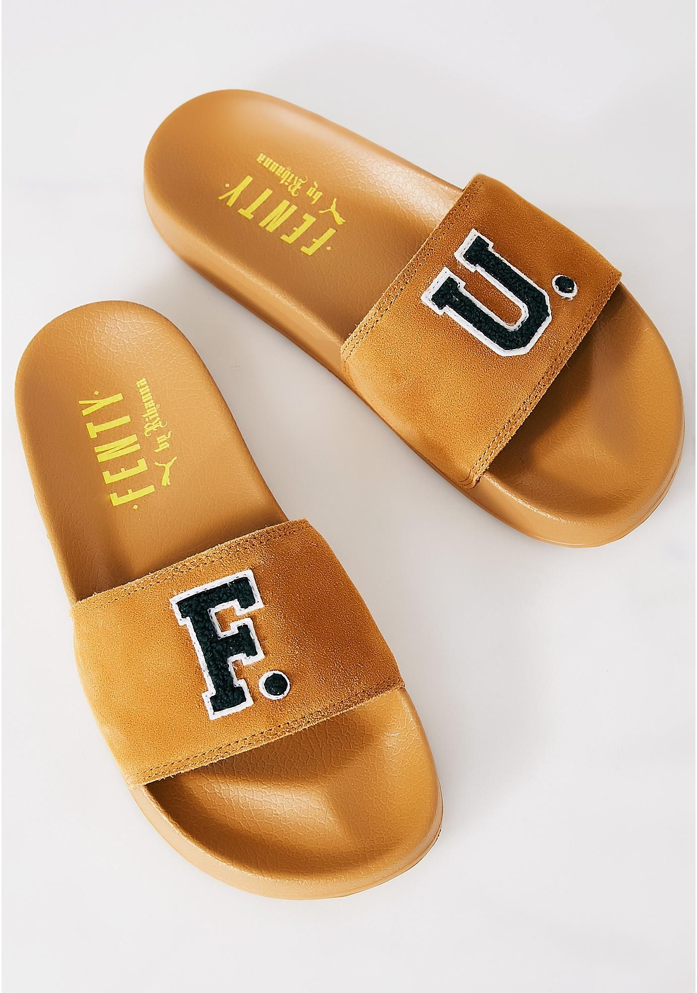 ef600f3fa84d86 PUMA FENTY PUMA By Rihanna Golden Brown Leadcat Fenty FU Slides cuz you  just want to slide right in. These slides have a suede strap featuring F  and U ...