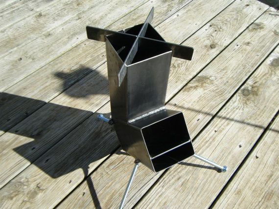 Brand new self feeding gravity feed rocket stove a for Wood burning rocket stove