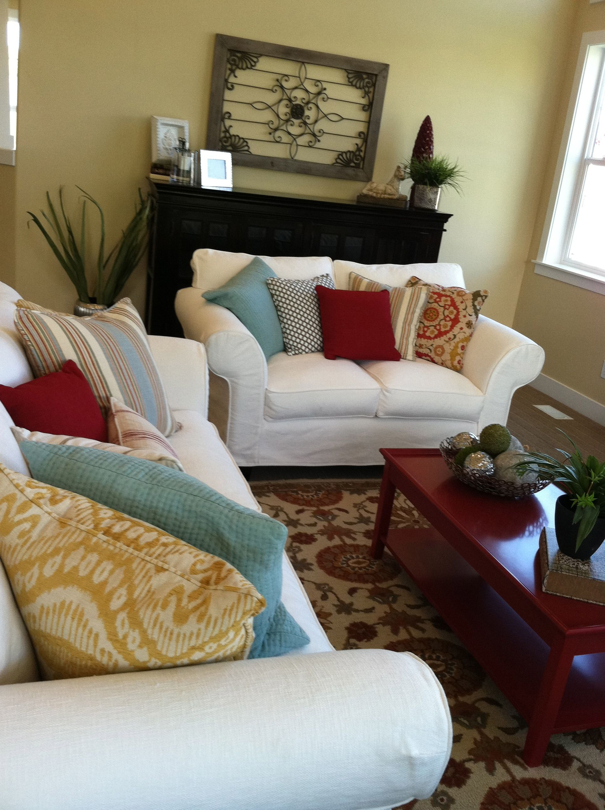 Love the multicolored pillows and how they all tie together