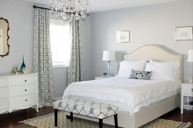 White Themed Bedroom With Padded Bed Headboard Classy Crystal Chandelier  Tribal Patterned Carpet On Wood Floor
