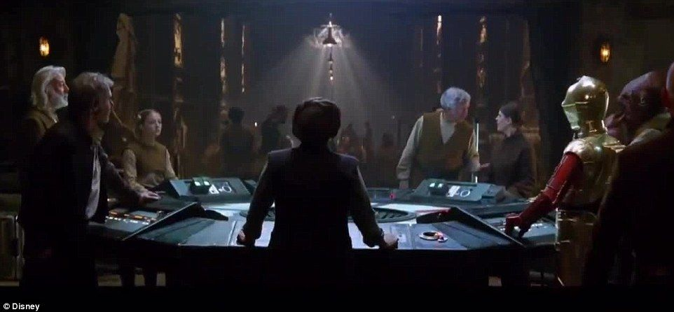 The backside of Leia: Princess Leia, who is now a General, was at what looked to be a rebel headquarters; Han is on her left and C-3PO is off to her right with what appears to be Admiral Ackbar