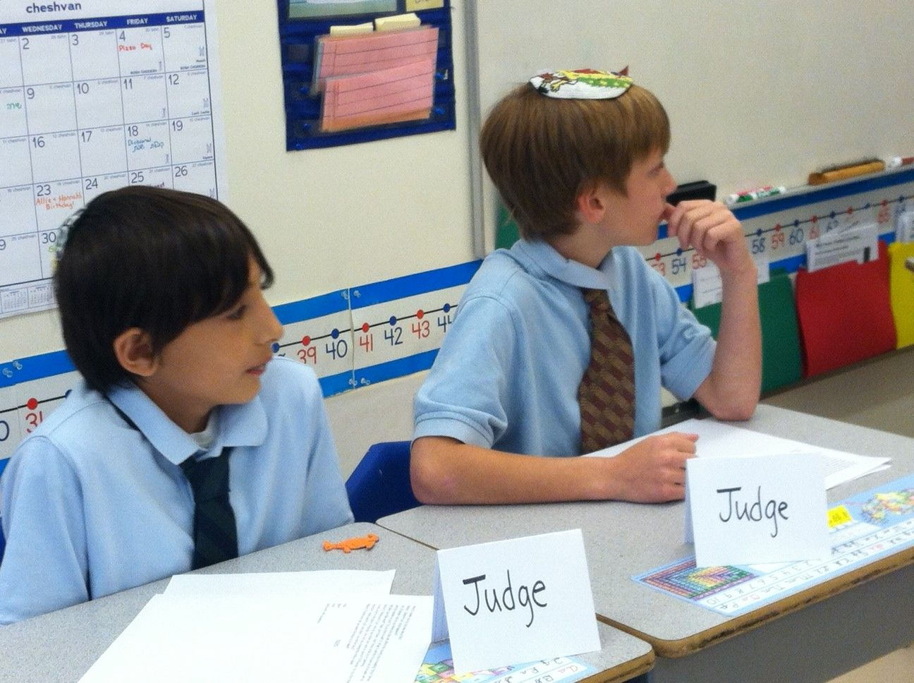 The judges hearing both sides of the argument in the Torah debate