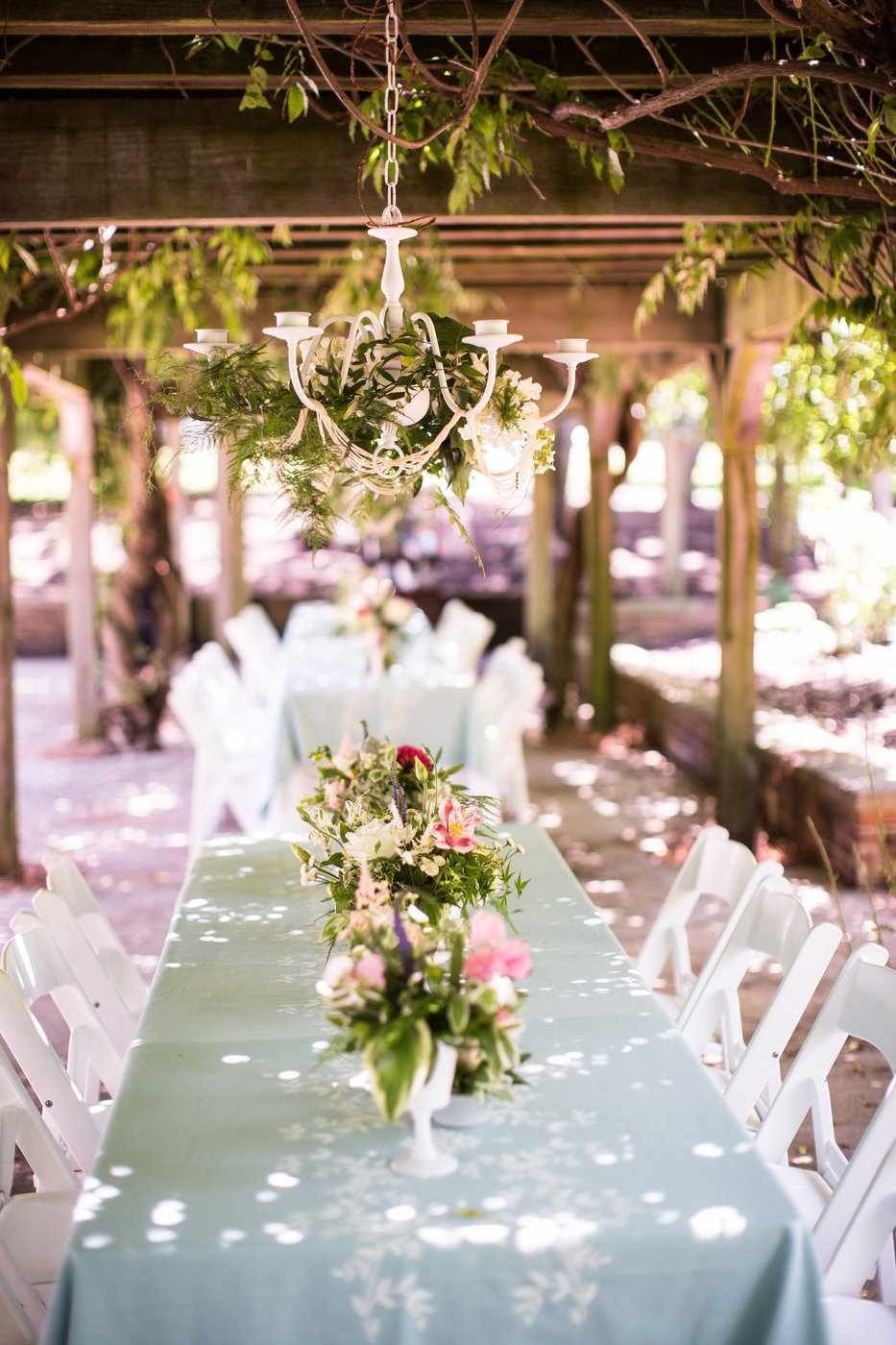 Arbor Seating For A Garden Party Wedding Reception With Floral