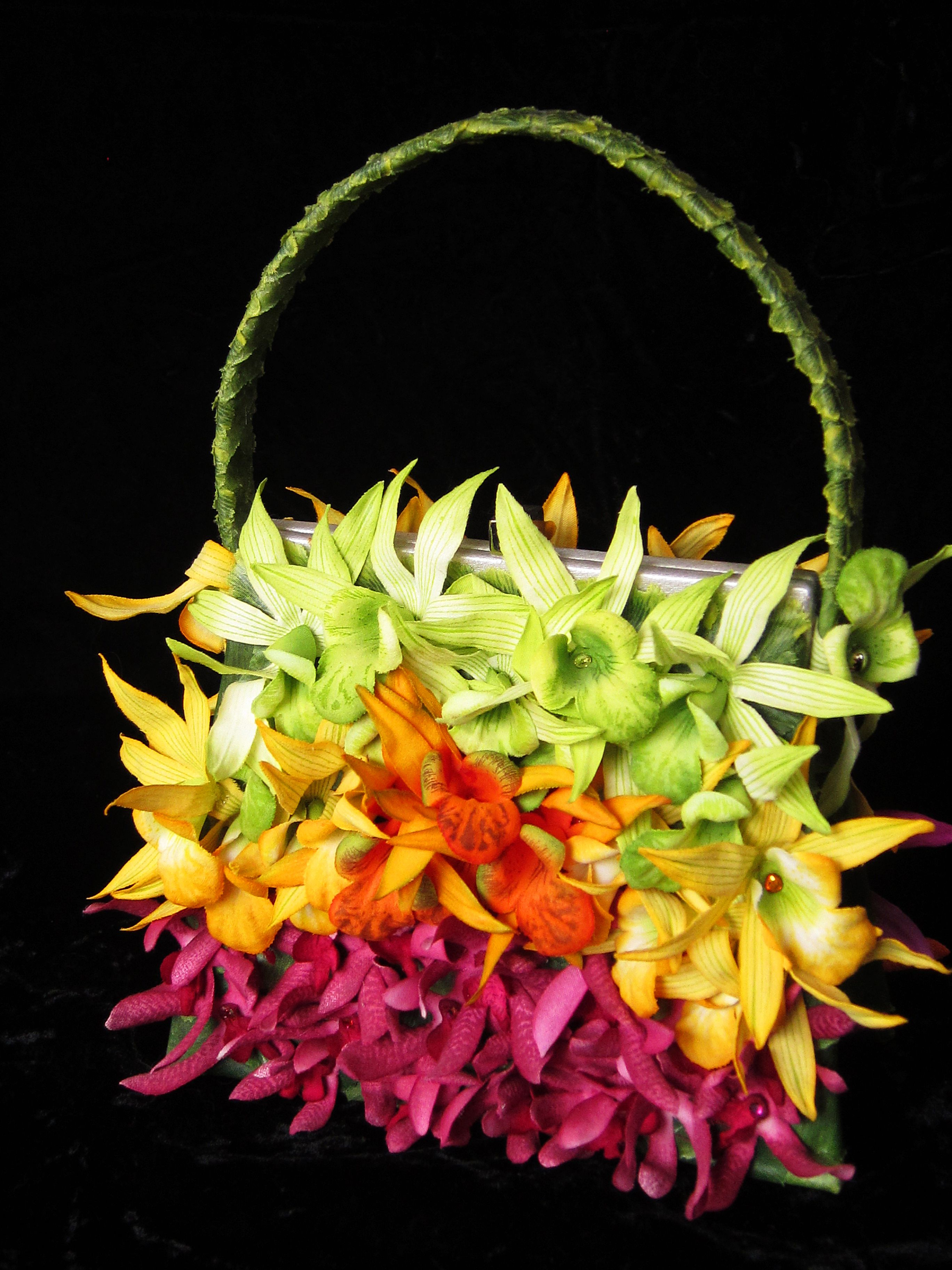 EJ STERN designs one-of-a-kind luxurious  handbags.$ 200 Constructed with the finest European couture silk/velvet flowers and leaves.