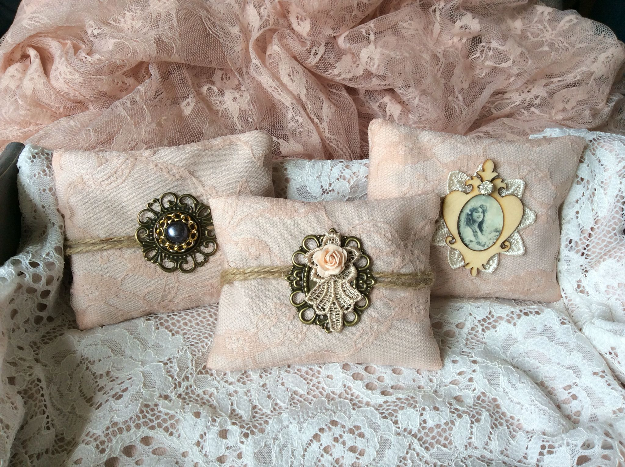 Handmade lavender mini pillows decorated with lace and vintage style