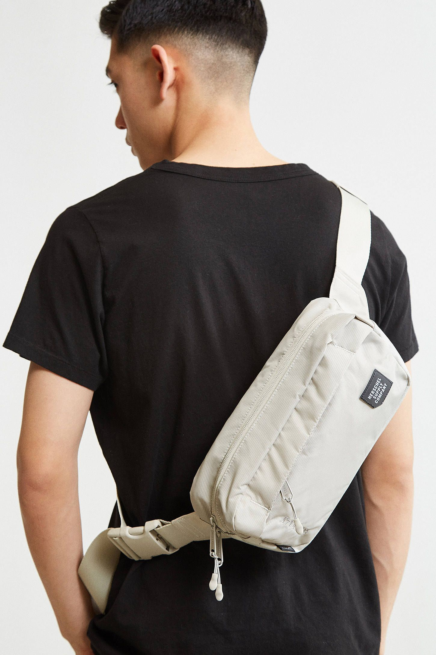 b1b03ba90db Shop the Herschel Supply Co. Tour Medium Sling Bag and more Urban Outfitters  at Urban Outfitters. Read customer reviews