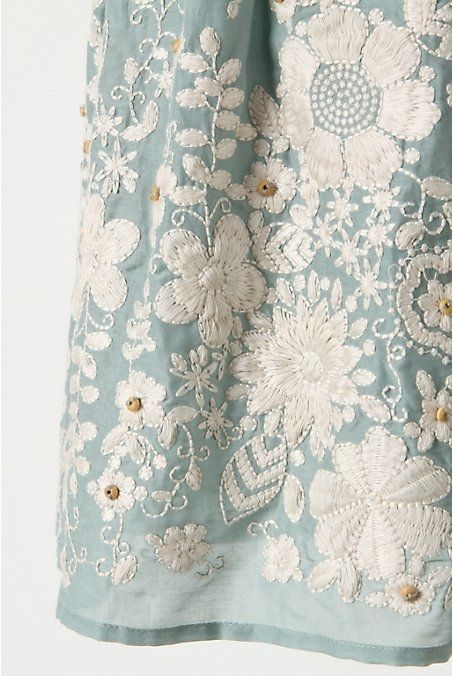 White on faded aqua - applique and embroidery.  Look for a blue/white print that could be embellished with embroidery and add wooden beads.  Make a pillow.