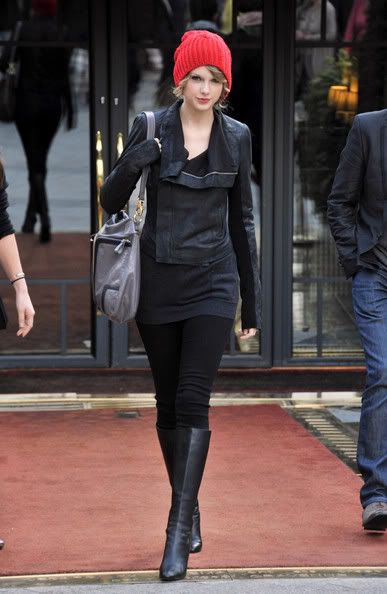 taylor swift wears a red beanie, black leather jacket and black boots