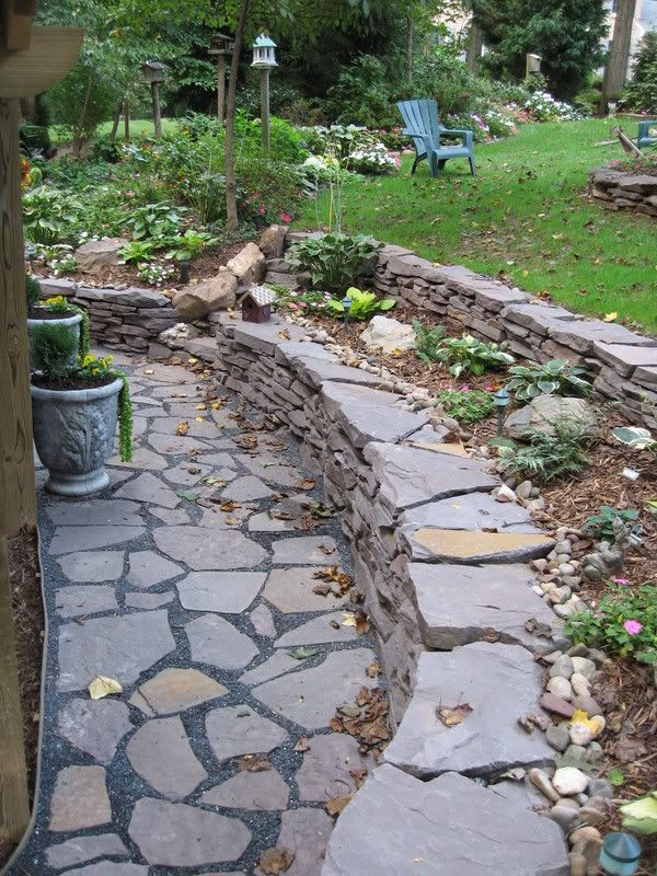 sloped backyard and stone wall steps