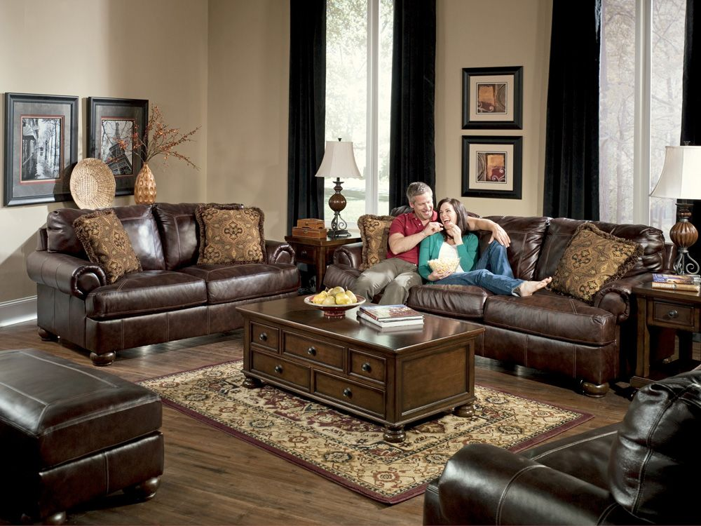 Living rooms with dark brown leather couches axiom for Living room ideas ashley furniture