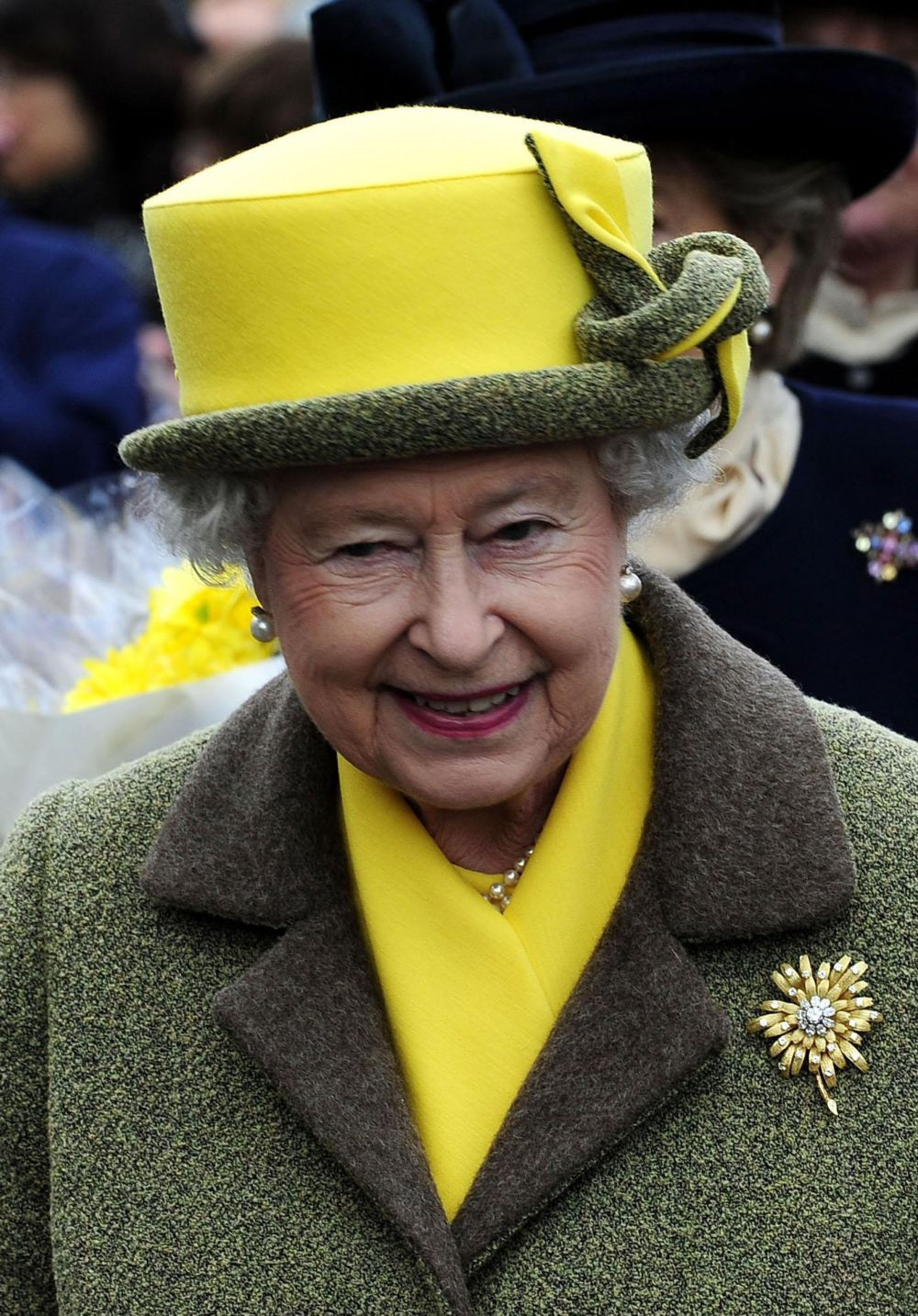 Queen Elizabeth wearing her Frosted Sunflower Brooch.  The hat is lovely...beautiful and fun #queenshats