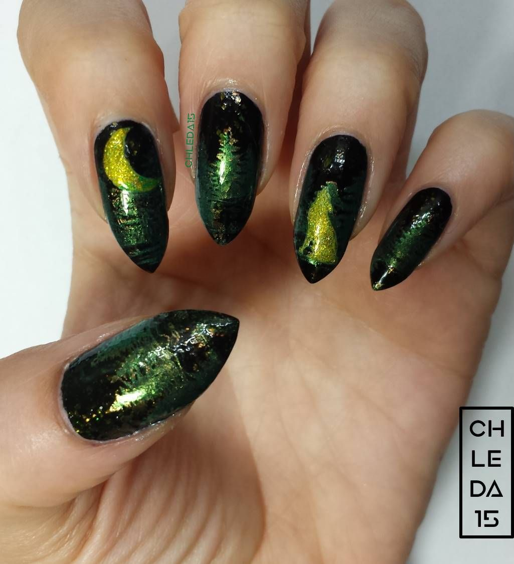 All nails painted with black with green chrome flakies for base ...