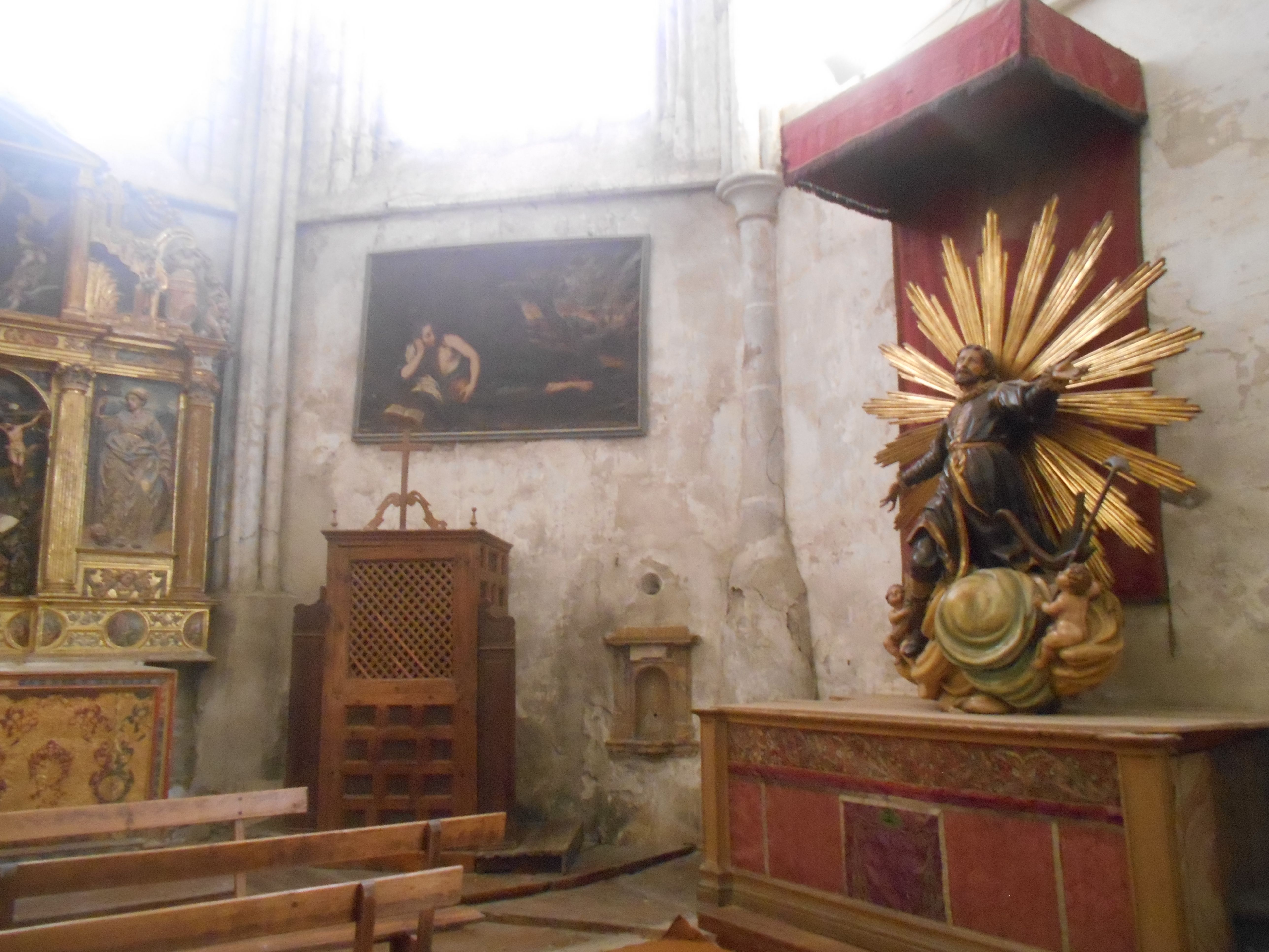 Pintura con toques tenebrístas y escultura de San Isidro. capilla de San Isidro o de San Jerónimo