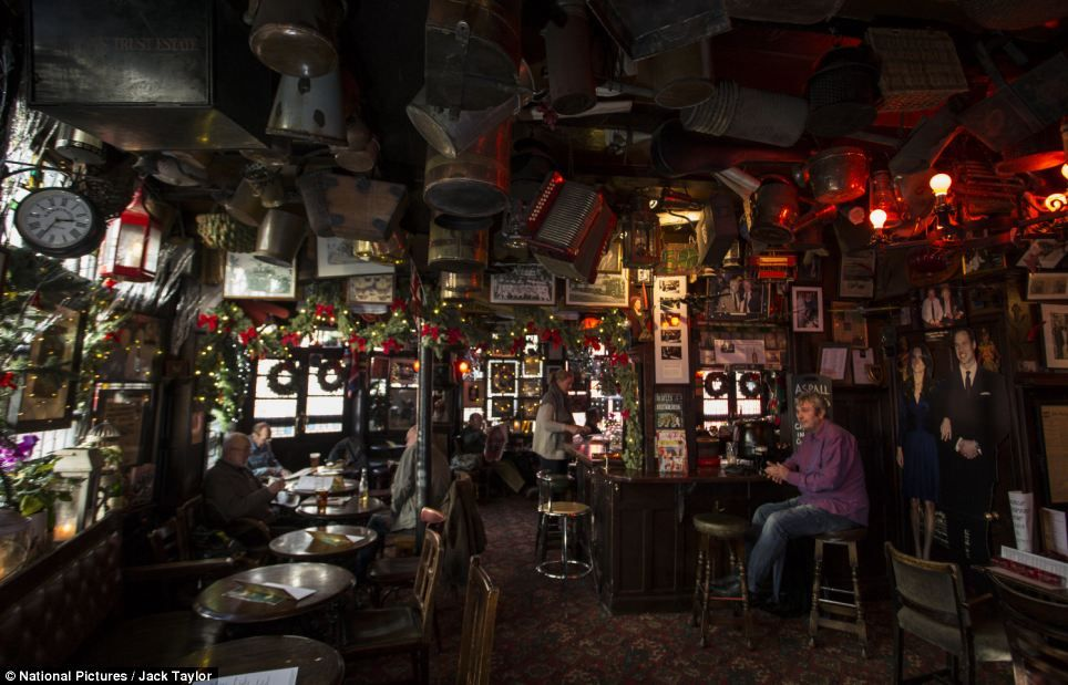 The Memorabilia Laden Interior Of The Churchill Arms Which Has A