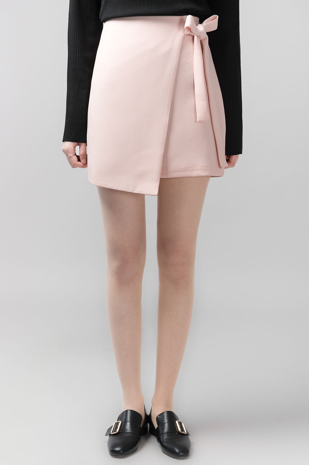 #mixxmix Ribbon Wrap Mini Skirt (BWSJ) Cute and sleek, this mini skirt has that trendy wrap style with ribbon fastening. #mxm #hideandseek #has #365basic #bauhaus #99bunny#koreanfashionstyle #girlsfashion #lovelywoman #kstyle #koreangirls #streetfashion #twinlook #dailyoutfit #styling