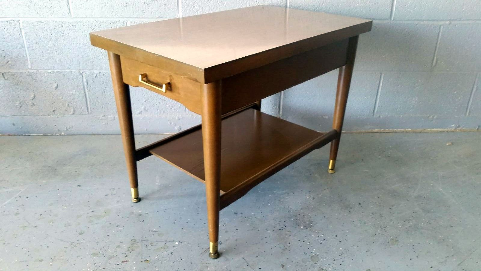 Mersman end table with laminate top drawer and magazine shelf