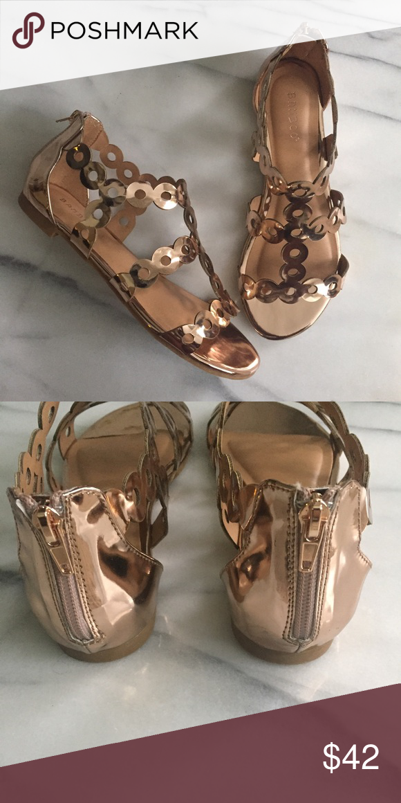 4667943f4 Rose Gold Geometric Strappy Sandal Stunning, metallic rose gold hue. Back  zip closure. New in box. True to size, in my opinion. Shoes Sandals