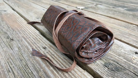 48 count leather pencil roll in alligator print.