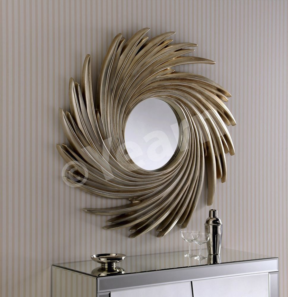 The Venice Mirror comes in a silver finish A striking sunburst mirror that would enhance any interior The mirrored centre piece comes with bevelled