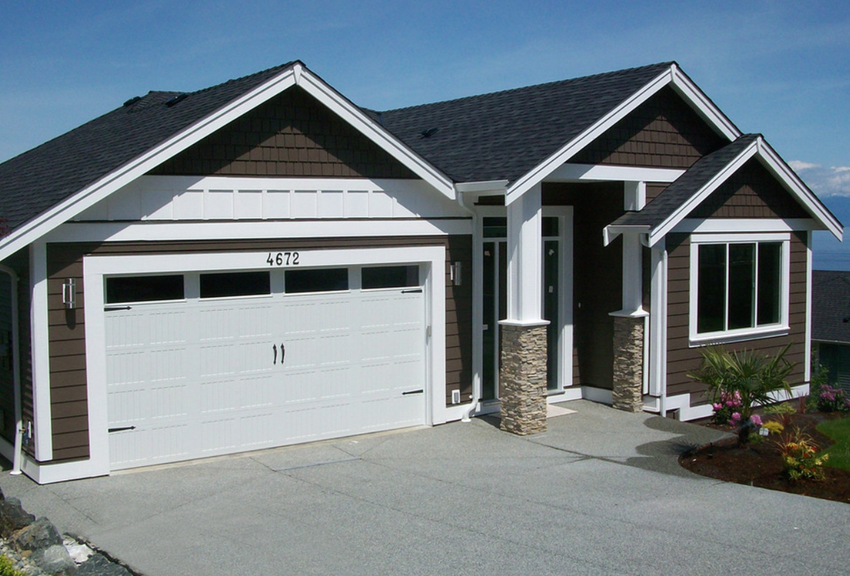 Kaycan vinyl siding cabot brown siding with white trims for Vinyl siding contemporary homes
