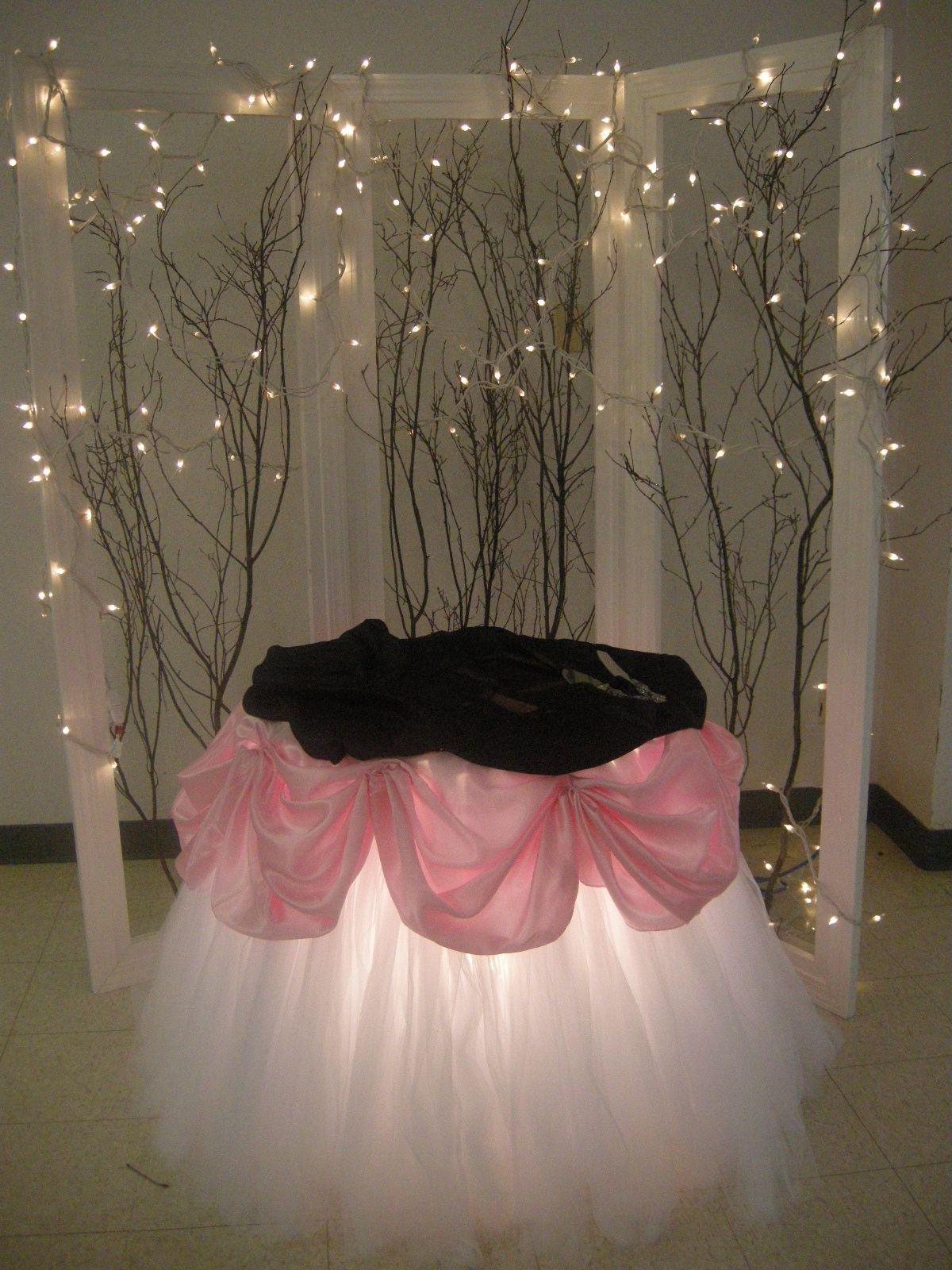 Cake table pink and black with tutu skirting and uplighting boda