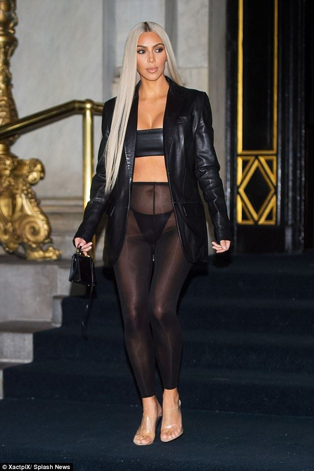 d4b7706ee3 Eye catching  Kim Kardashian paired her lighter locks with sheer leggings  for the Daily Front Row s Fashion Media Awards in New York City