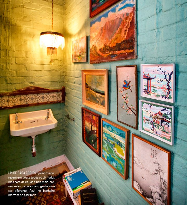 Those paintings look great on that painted brick wall