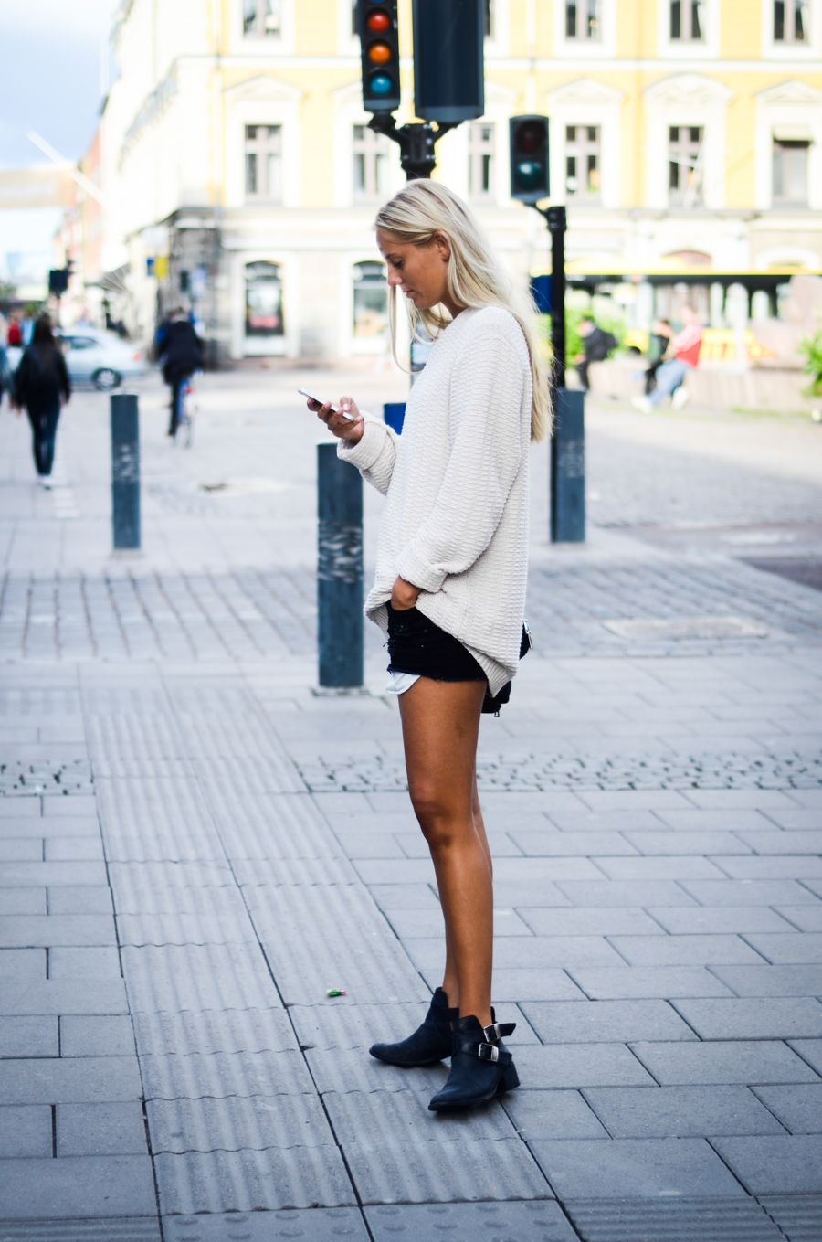 Rockin booties, and an oversized sweater make black denim shorts a ...
