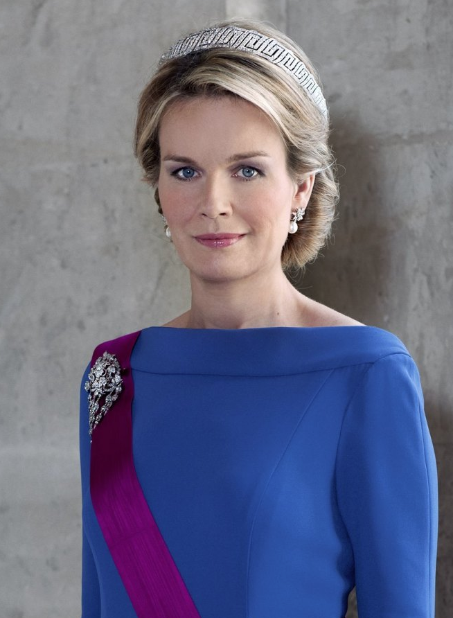 Queen Mathilde, Queen consort of the Belgians and wife of King Philippe, wearing the Nine Provinces Tiara, who wore the bandeau portion alone for her first formal gala portrait as queen consort. Belgium, (1926; made by Van Bever; diamonds).